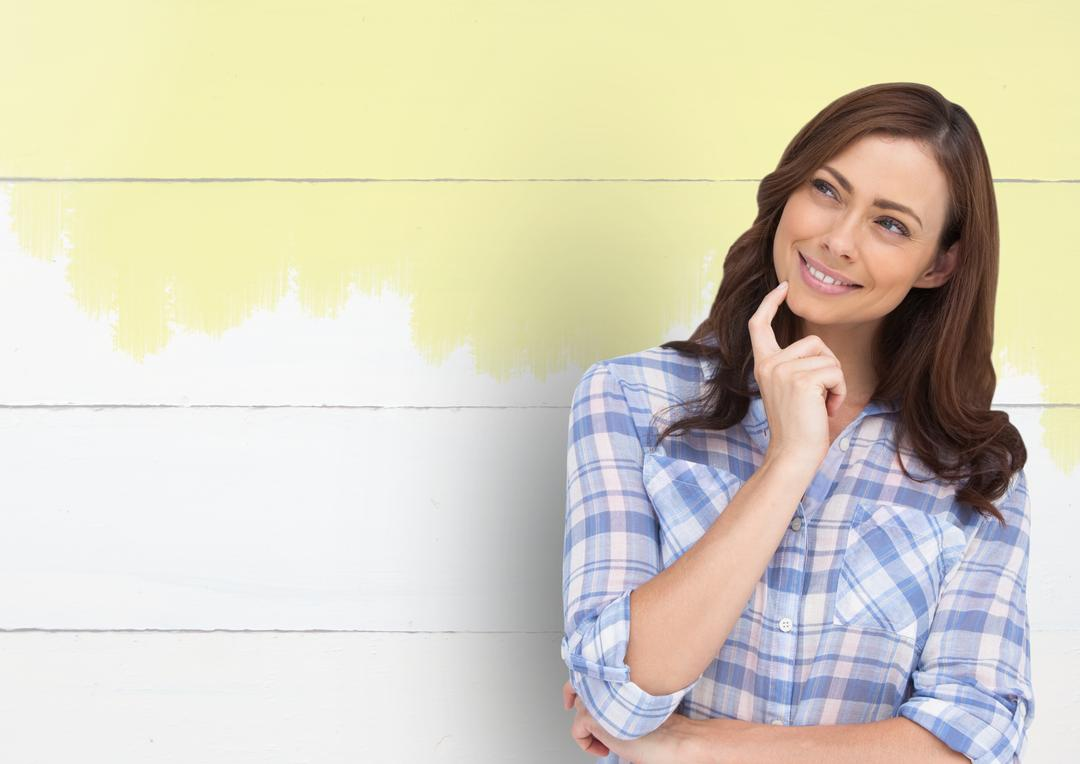 Digital composite of Woman thinking against painted wall