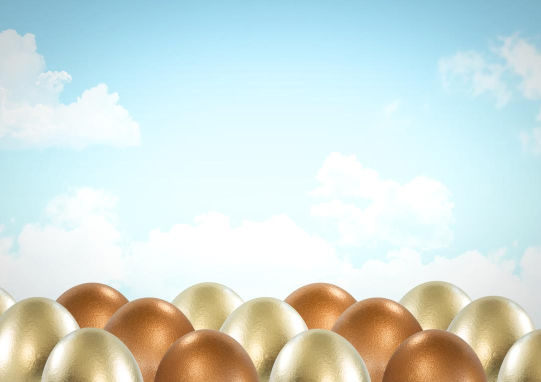 Digital composite of Easter eggs in front of blue sky