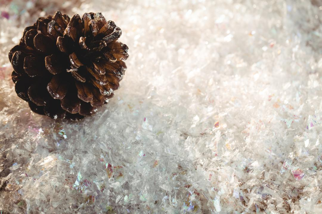 Pine cone decoration on fake snow during christmas time