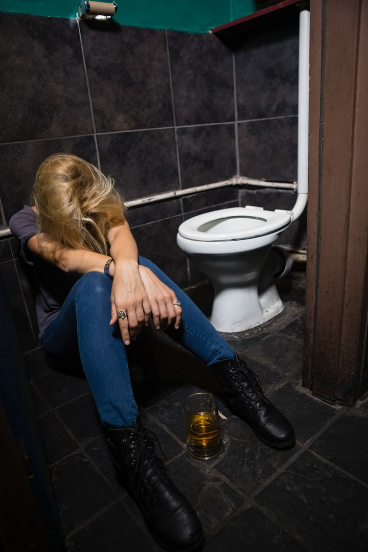 Unconscious woman sleeping in the washroom Free Stock Images from PikWizard