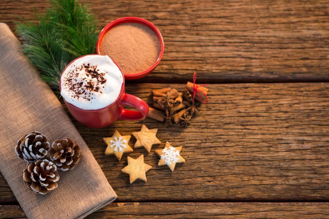 Pine cone, coffee cup, sweet food, cinnamon and christmas fir with napkin on wooden plank
