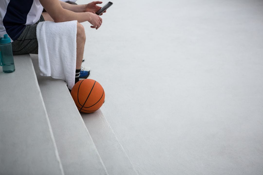 Basketball player using mobile phone