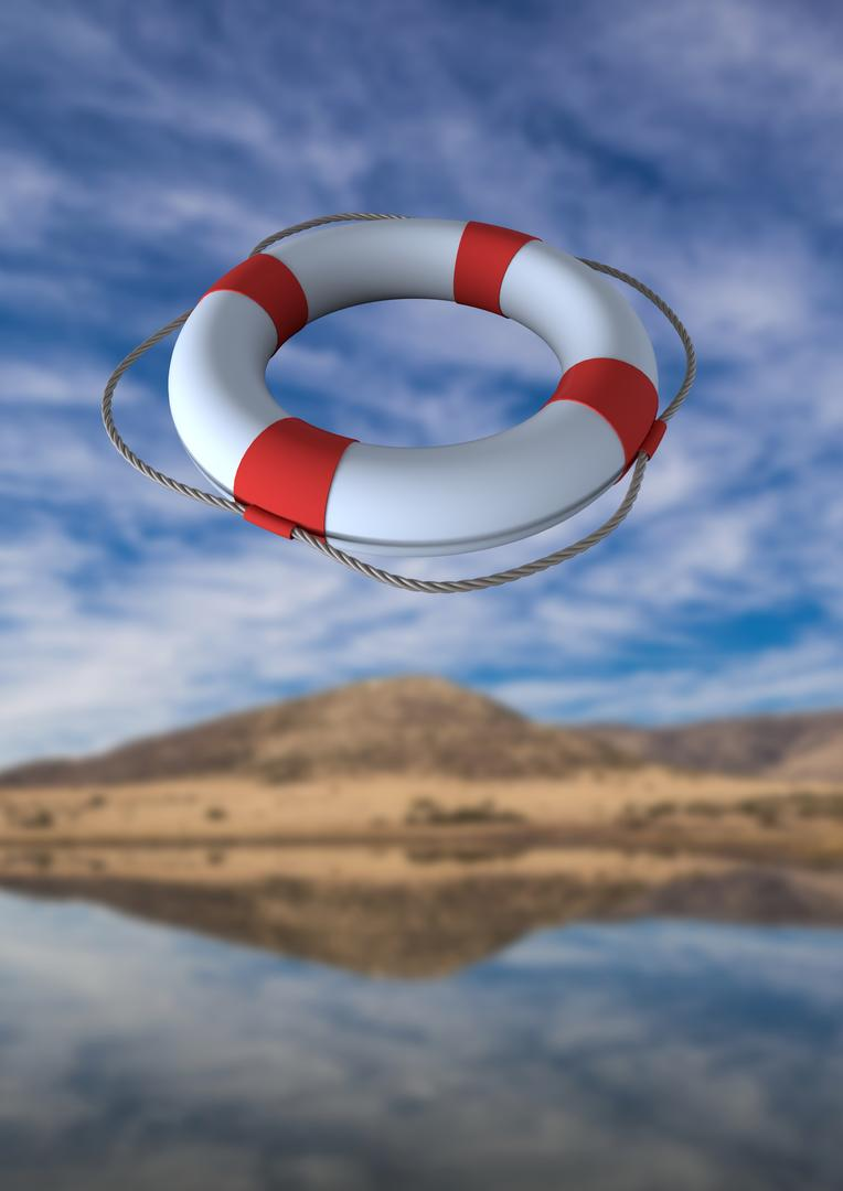 Digital composition of lifebuoy in air against river and mountains in background