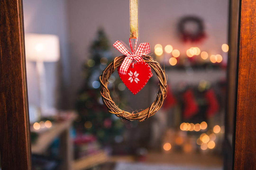 Close-up of christmas grapevine wreath with ribbon hanging on window Free Stock Images from PikWizard