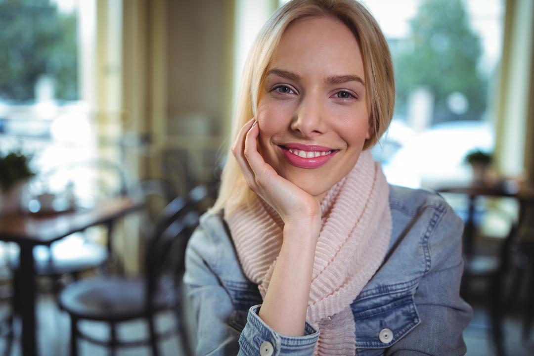 Portrait of smiling woman sitting in café