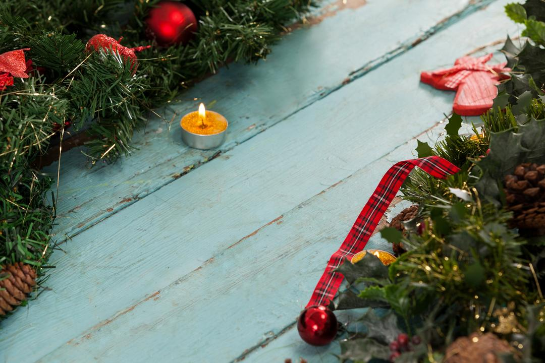 Christmas decoration with tealight candle on a plank Free Stock Images from PikWizard