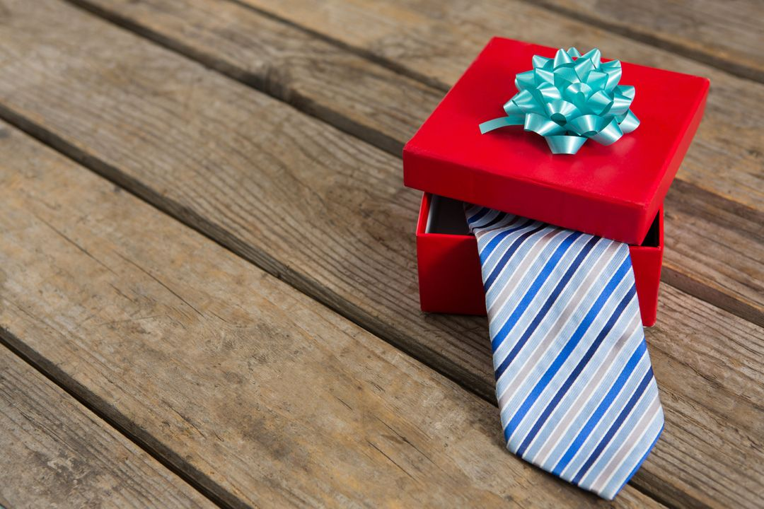 High angle view of necktie in gift box on wooden table Free Stock Images from PikWizard