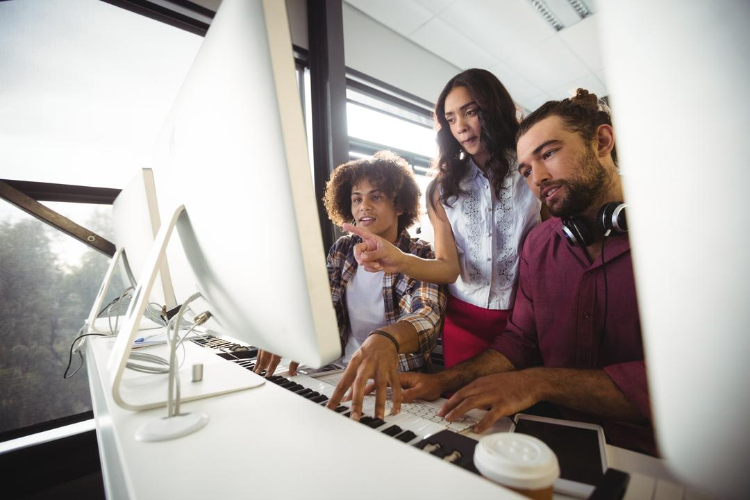 Image of Three People Working Together in an Office