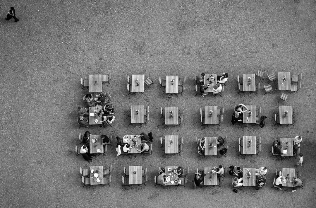 Black and white aerial shot of picnic benches