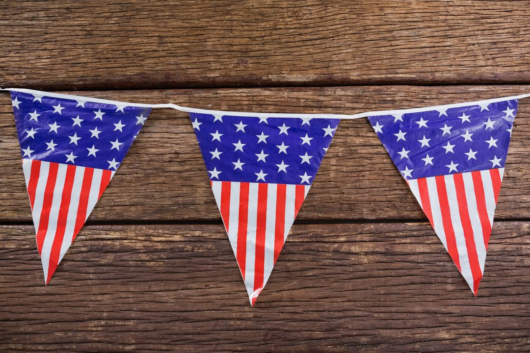 Close-up of patriotic bunting arranged on wooden table Free Stock Images from PikWizard