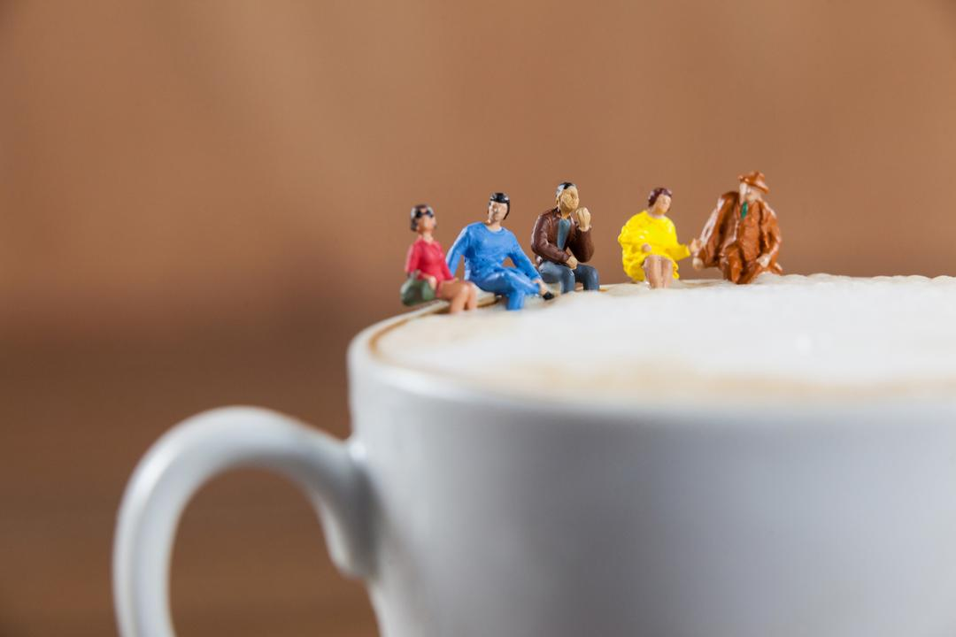 Conceptual image of miniature group of friends having coffee