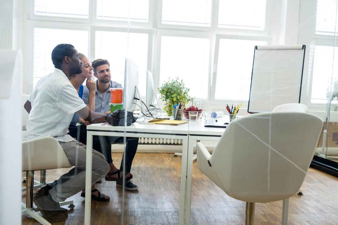 Group of graphic designers working on computer in office