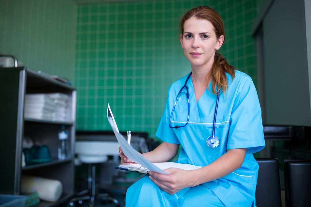 Portrait of nurse holding medical report at the hospital Free Stock Images from PikWizard
