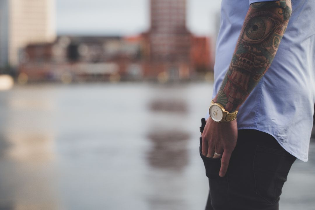 Image 9 How To Start A Fashion Blog - Tattooed man with white t-shrit and gold watch.
