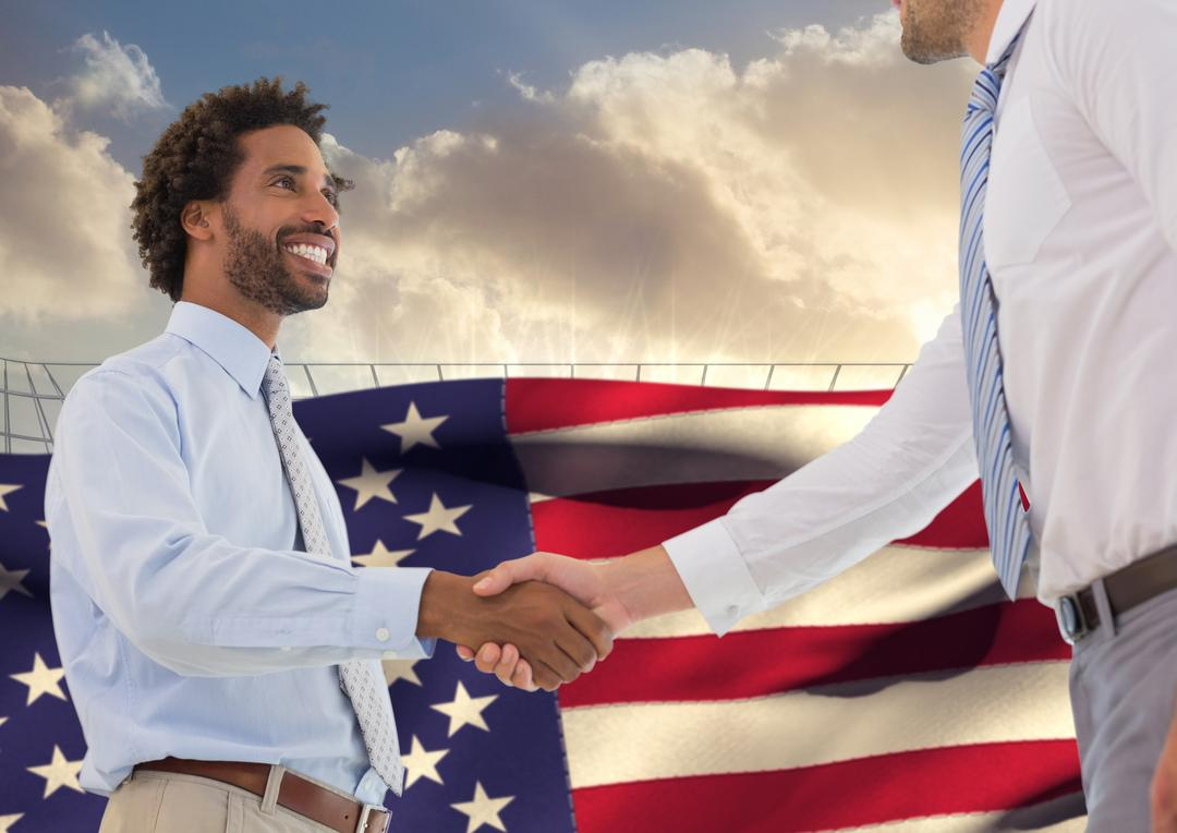 Happy businessmen shaking hands against american flag in the background Free Stock Images from PikWizard