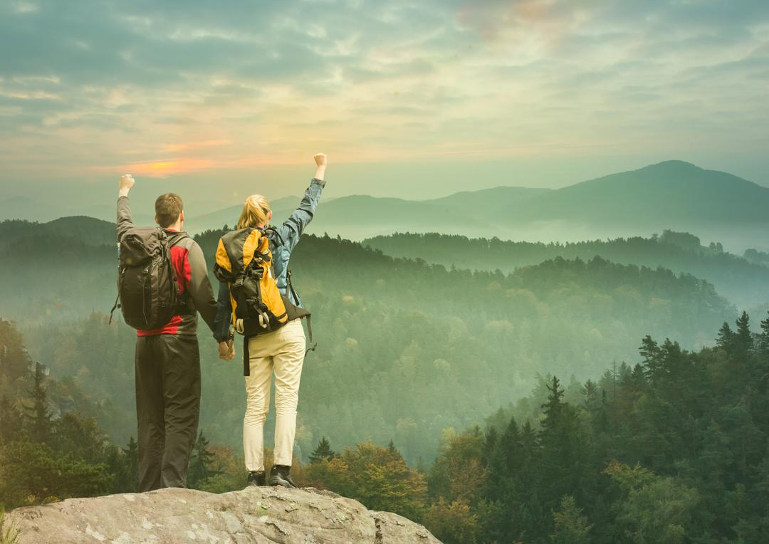 Digital composite of Couple conquer the mountains. Free Stock Images from PikWizard