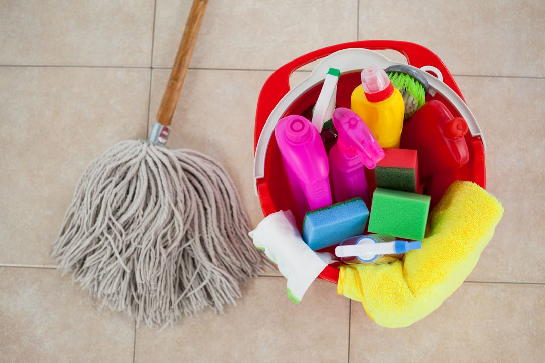 Close-up of bucket with cleaning supplies and mop on tile floor Free Stock Images from PikWizard