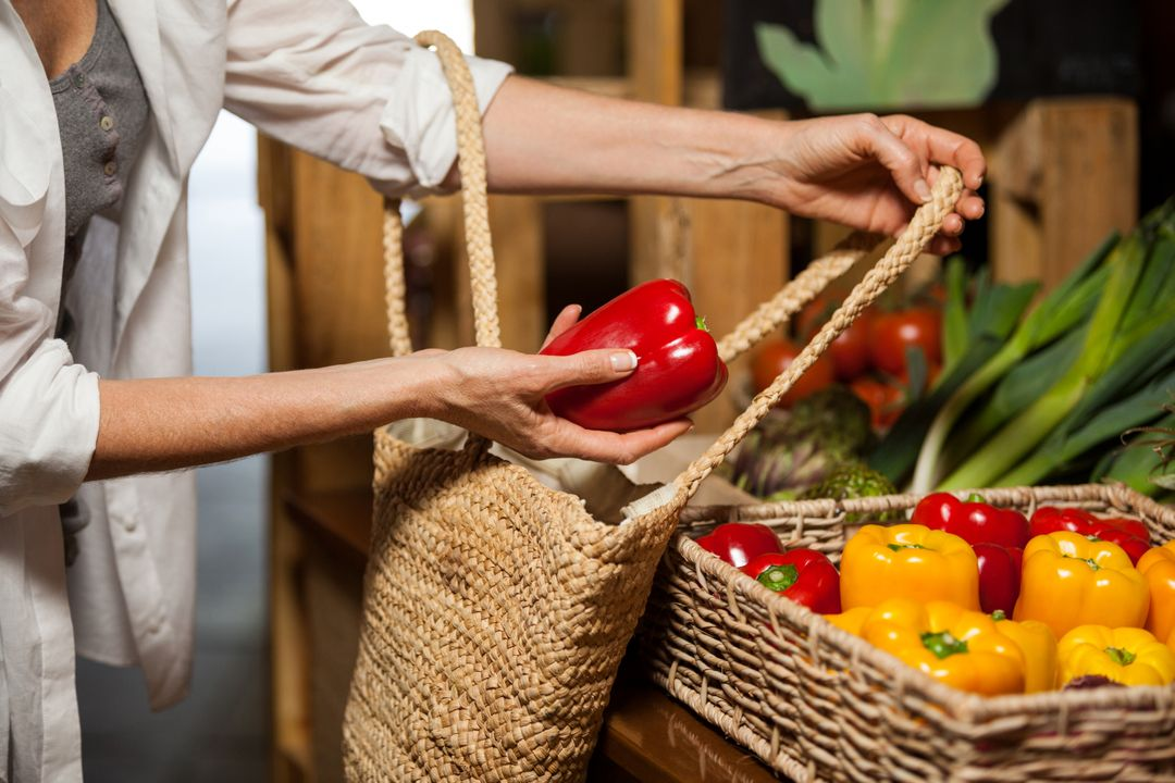 Woman buying bell pepper at organic section in supermarket Free Stock Images from PikWizard