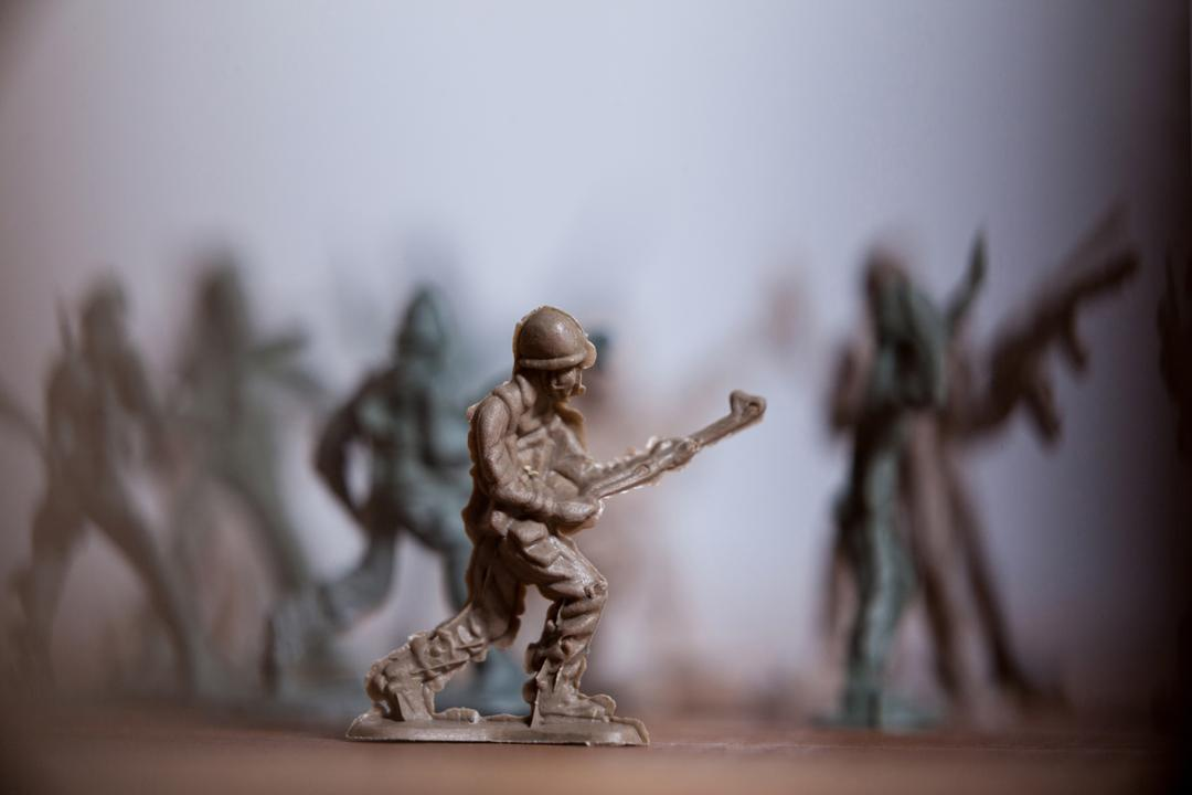 Miniature figurine of army soldier in a battle Free Stock Images from PikWizard