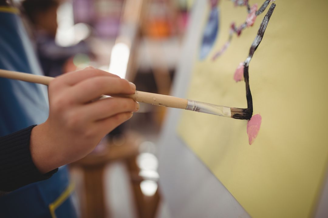 Mid section of schoolboy panting on canvas during drawing class Free Stock Images from PikWizard