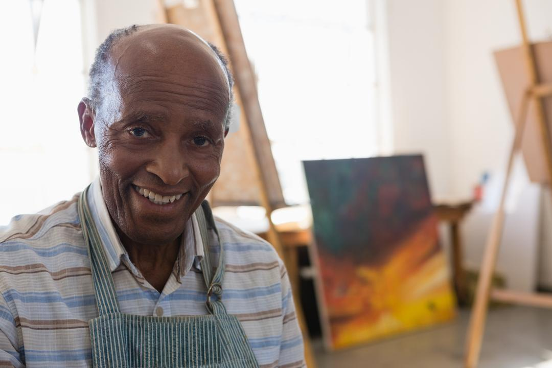 Close up portrait of smiling man sitting in art class Free Stock Images from PikWizard