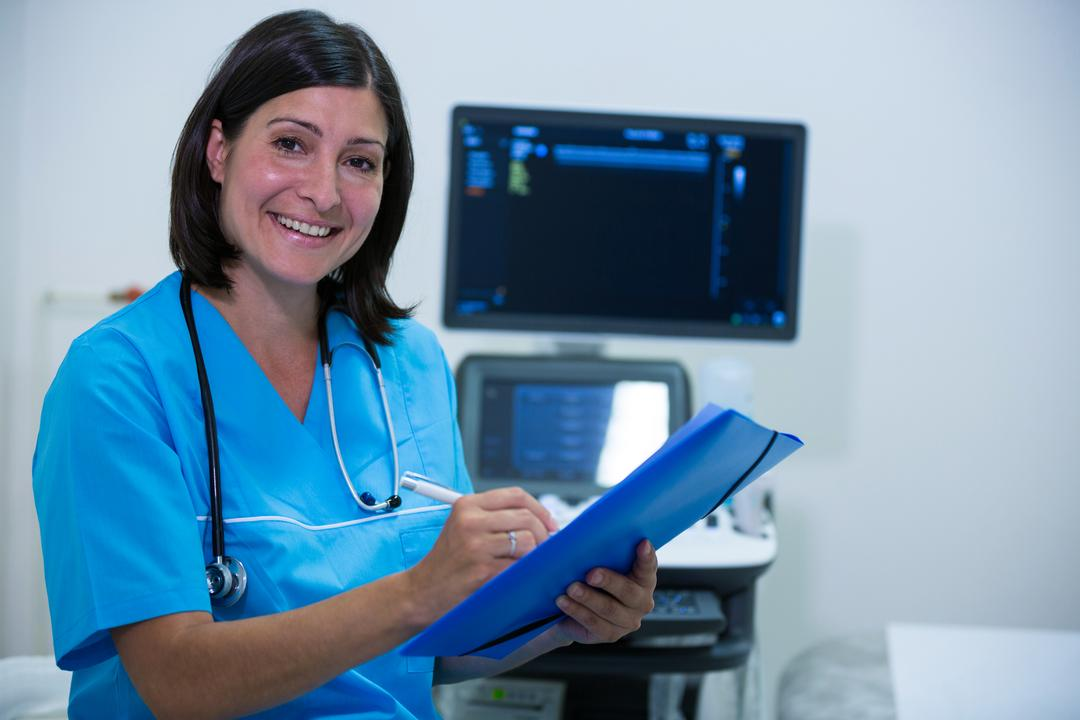 Portrait of female doctor writing on clipboard in hospital Free Stock Images from PikWizard