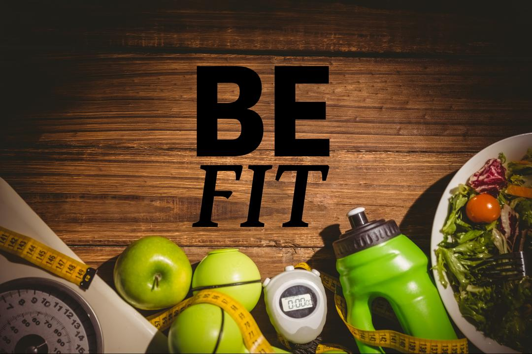 Digital composite of be fit message against table