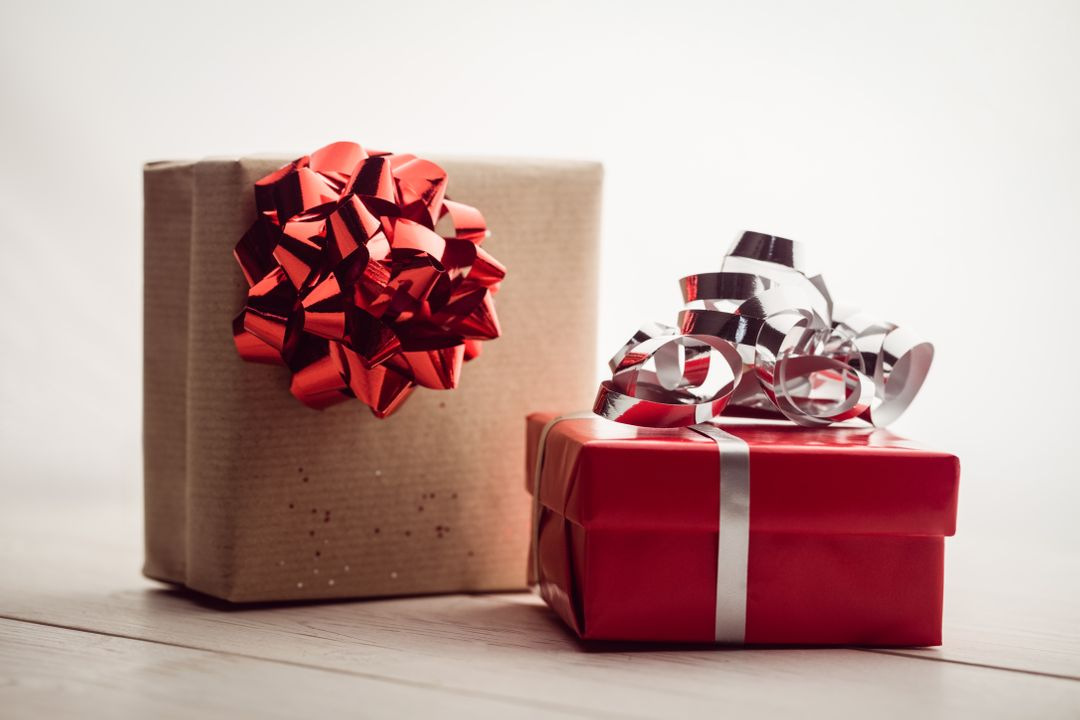 Two presents wrapped with ribbons and bows