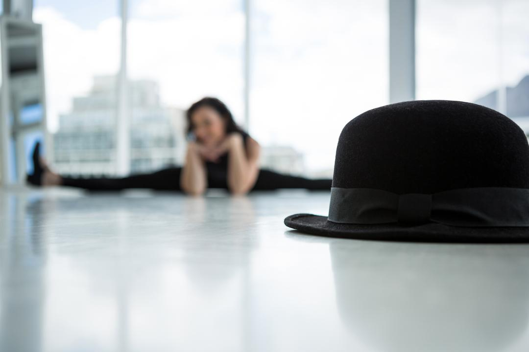 Close-up of hat with dancer in background Free Stock Images from PikWizard