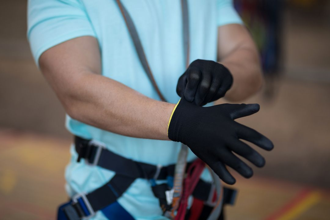 Mid section of man wearing gloves Free Stock Images from PikWizard