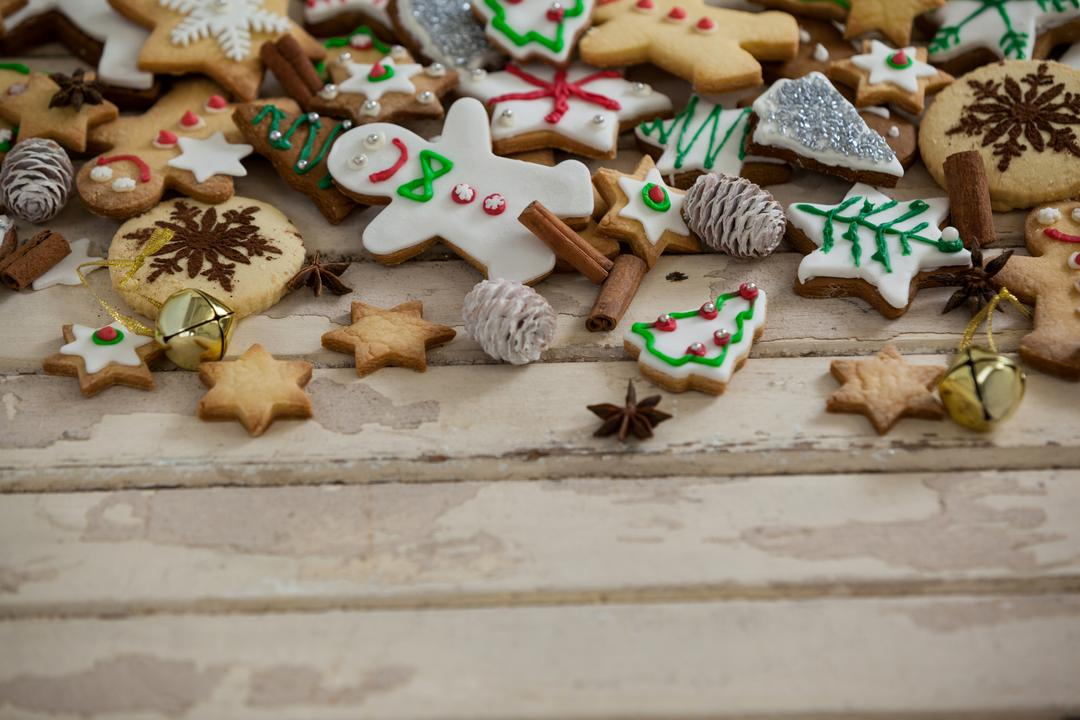 Various christmas cookies and decoration on a plank Free Stock Images from PikWizard