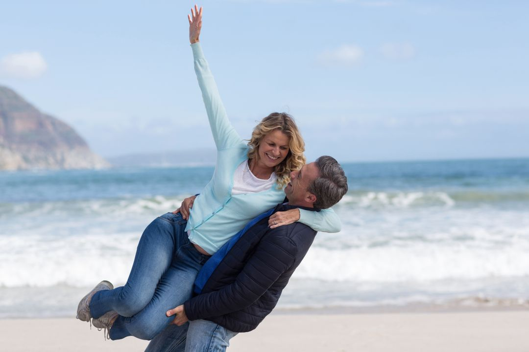Romantic mature couple enjoying on the beach Free Stock Images from PikWizard