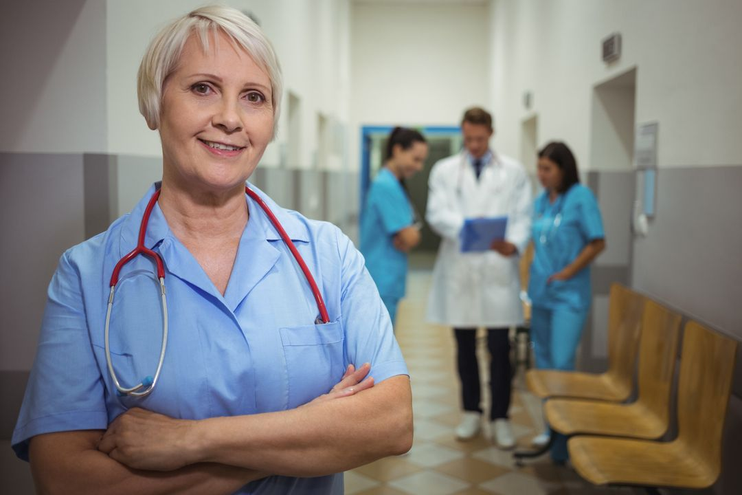 Portrait of female surgeon standing with arms crossed in corridor Free Stock Images from PikWizard