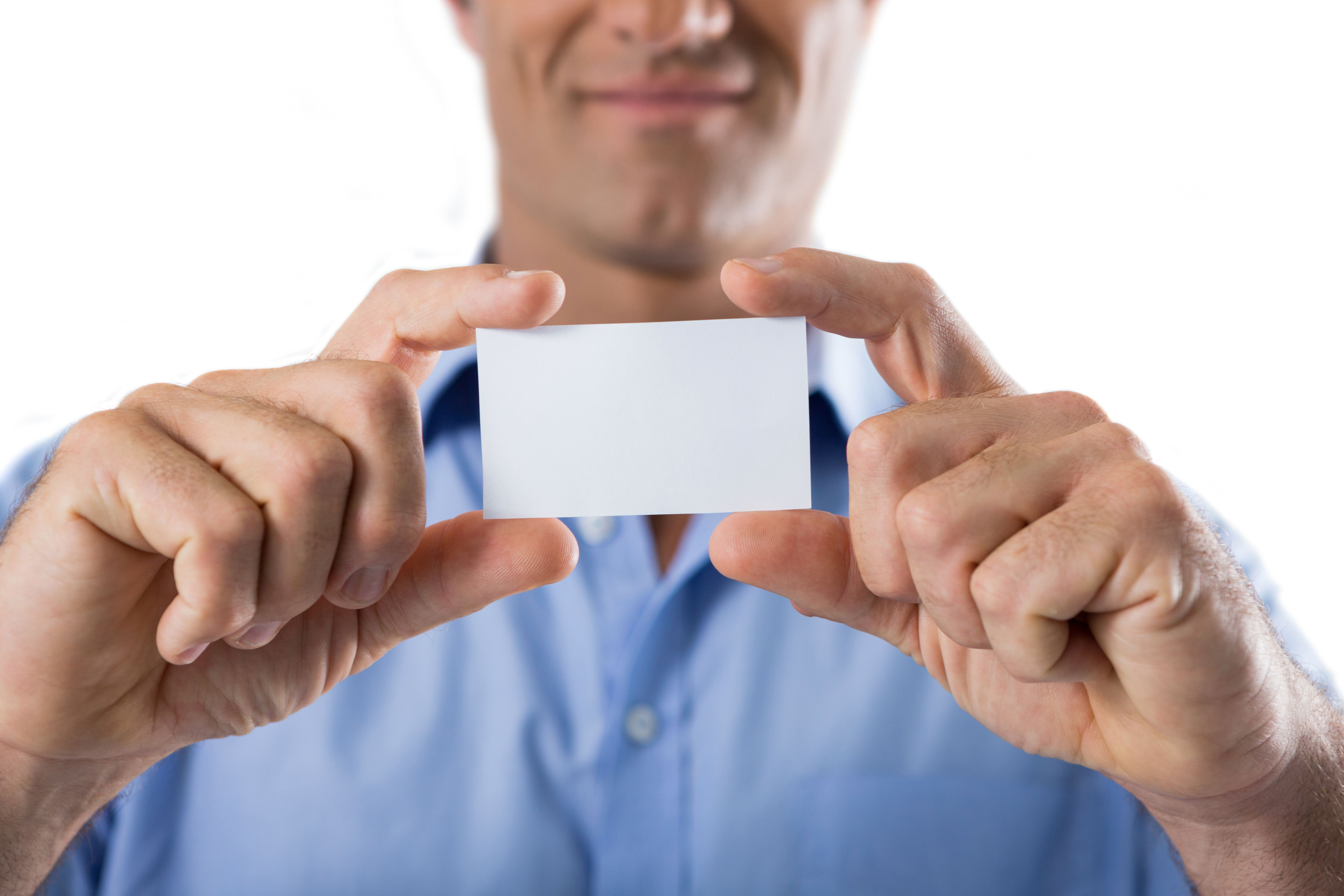 male executive holding a blank business card photo from