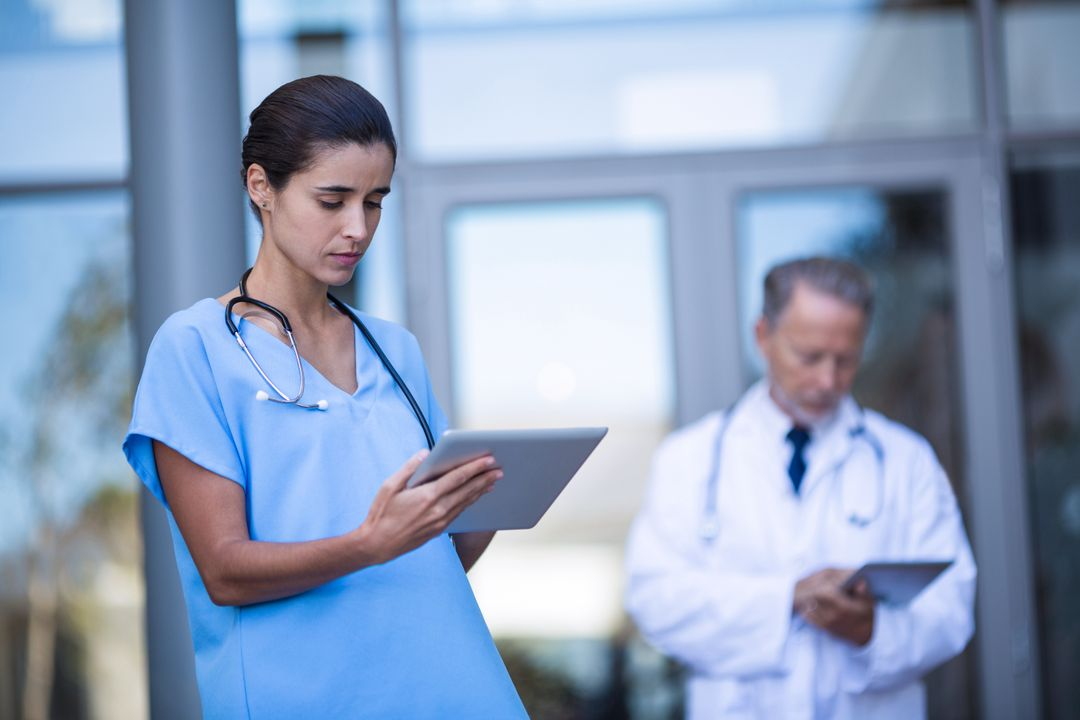 Doctor and nurse using digital tablet in hospital