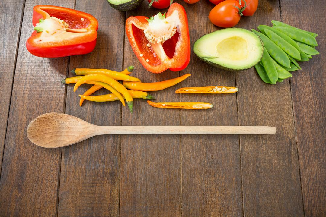 Various vegetable ingredients and spoon on wooden board Free Stock Images from PikWizard