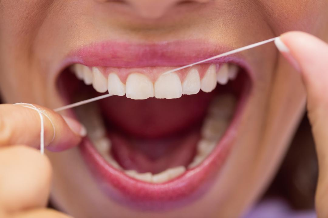 Close-up of female patient flossing her teeth in dental clinic Free Stock Images from PikWizard