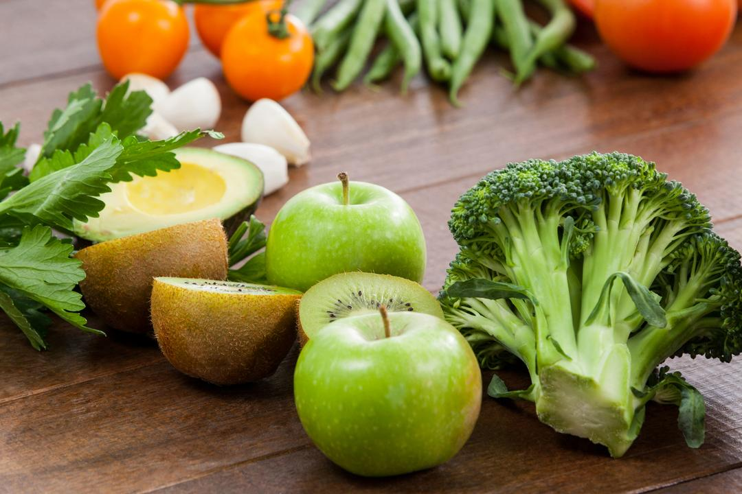 Close-up of various fresh vegetables and fruit on table - diet concept