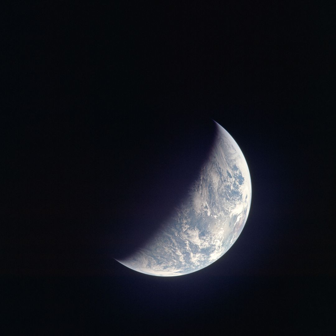 AS12-50-7362 (14 Nov. 1969) --- A view of one-third of Earth, with Australia on the horizon, as photographed by the three-man crew of Apollo 12. The Command and Service Modules, mated to the Lunar Module (yet to be removed and transpositioned for landing) were en route to the moon for man's second mission there. Onboard the spacecraft were astronauts Charles Conrad Jr., Richard F. Gordon Jr. and Alan L. Bean. Photo credit: NASA