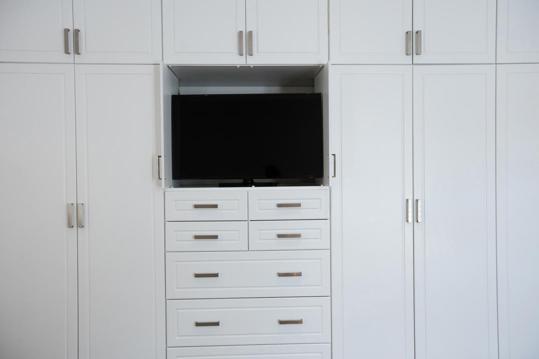 Empty wardrobe with television in living room at home