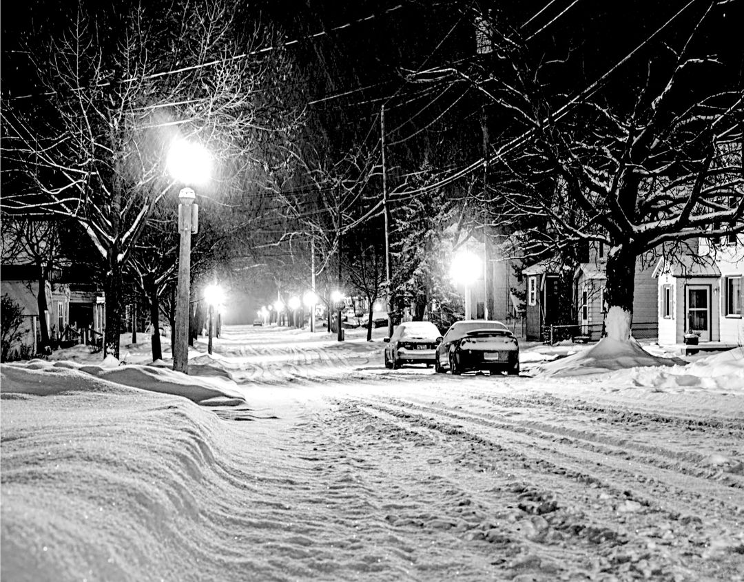 Illuminated Street Light on Snow Covered City