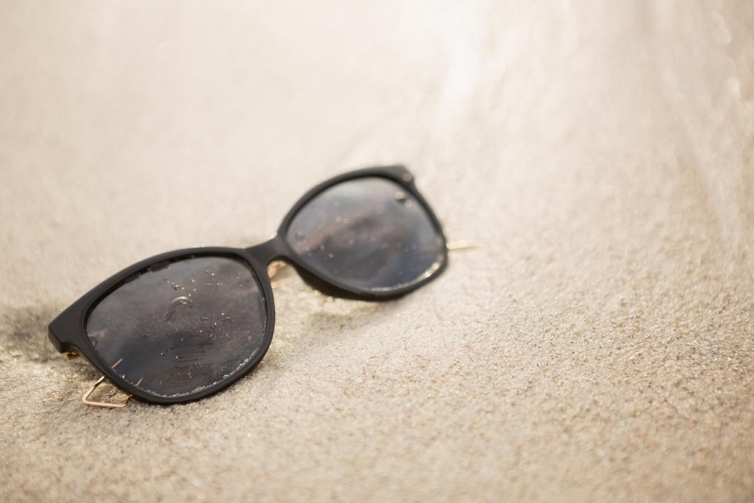 Sunglass kept on sand