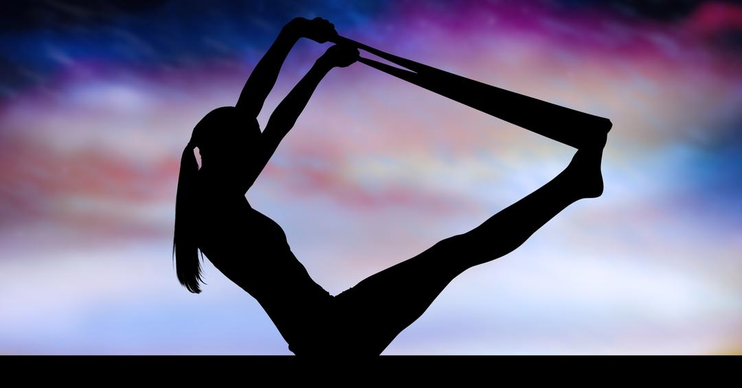 Silhouette of healthy woman practicing yoga on against sky background