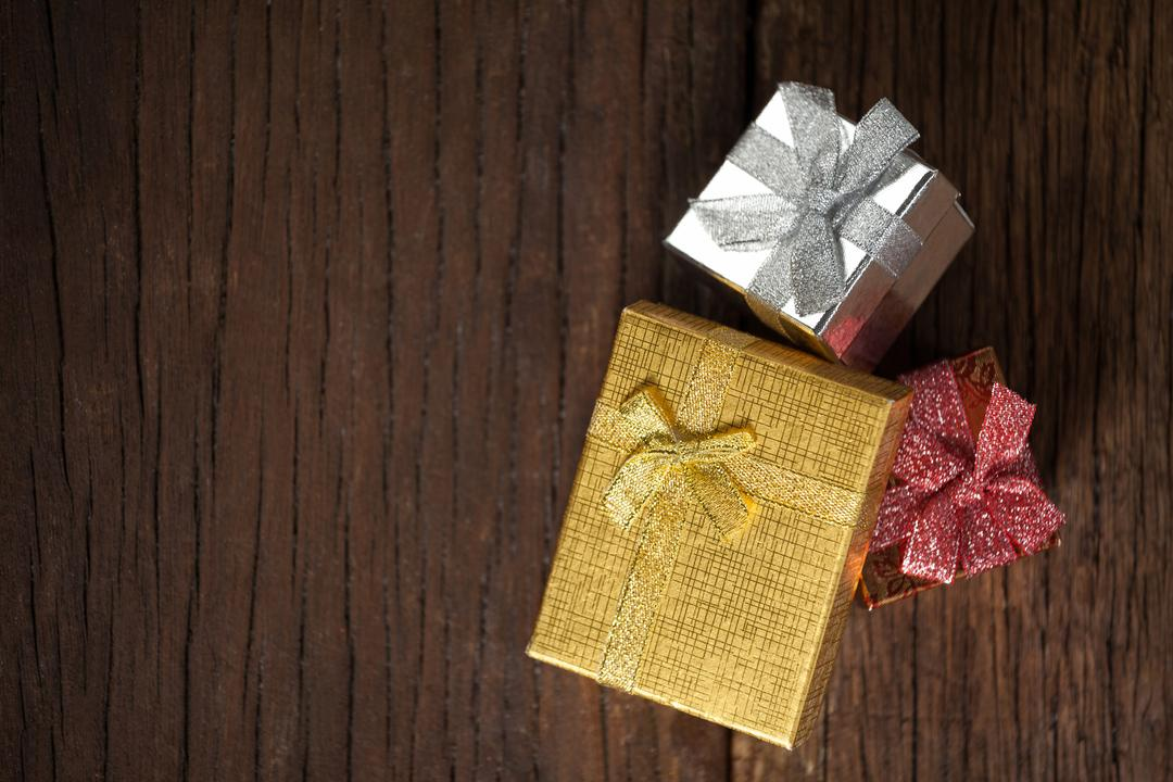 Wrapped gift boxes on wooden table during christmas time Free Stock Images from PikWizard