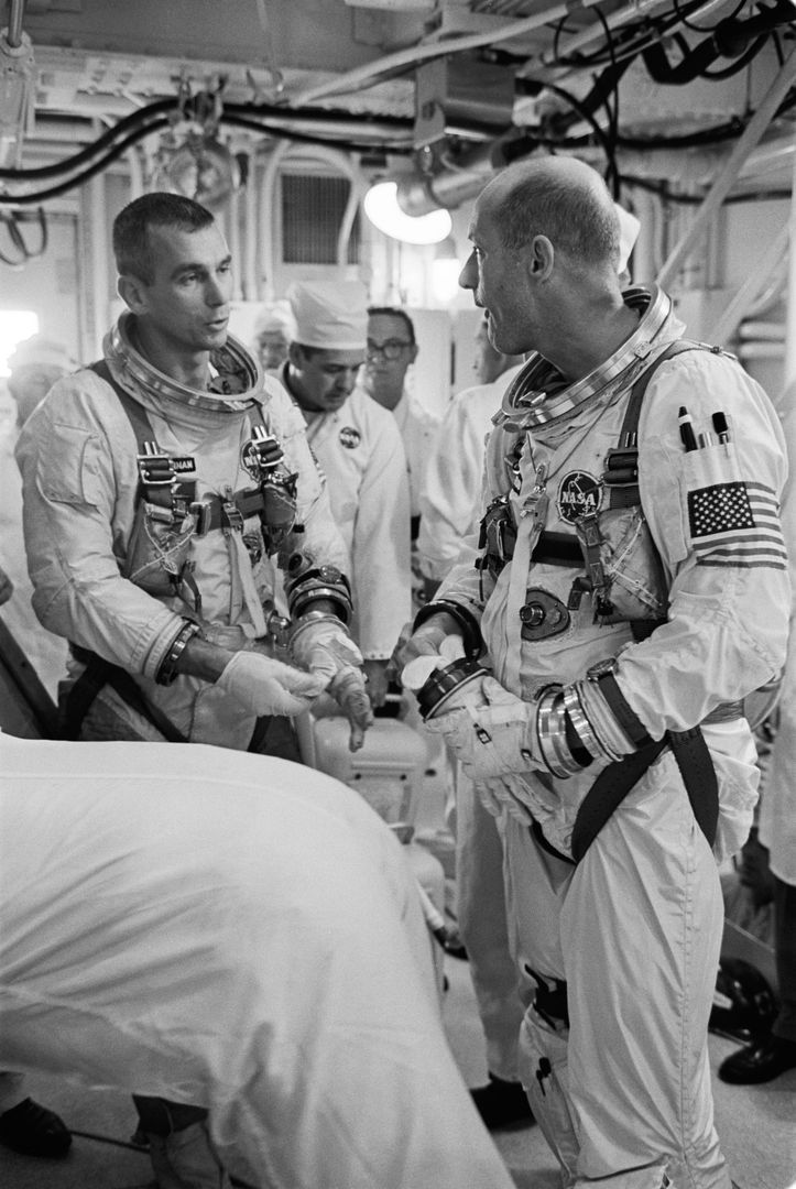S66-32044 (17 May 1966) --- Astronauts Eugene A. Cernan (left), pilot, and Thomas P. Stafford, command pilot, discuss the postponed Gemini-9 mission just after egressing their spacecraft in the white room atop Pad 19. The Agena Target Vehicle failed to achieve orbit, causing a termination of the mission. The spaceflight (to be called Gemini-9A) has been rescheduled for May 31. A Gemini Augmented Target Docking Adapter will be used as the rendezvous and docking vehicle for the Gemini-9 spacecraft. Photo credit: NASA