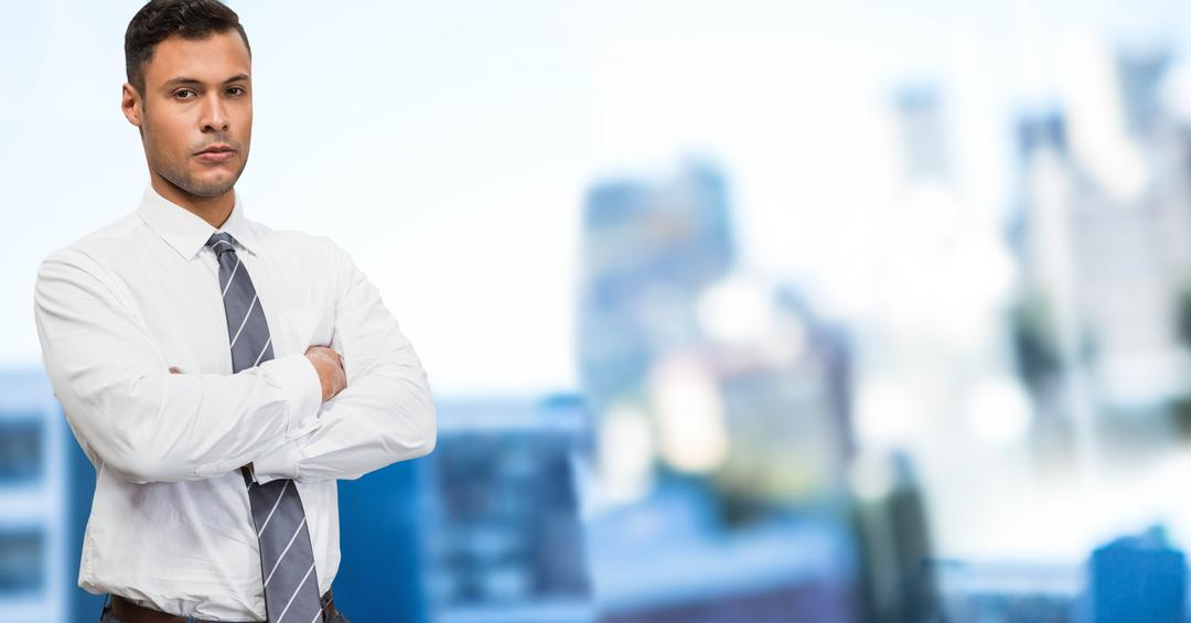 Digital composition of businessman standing with arms crossed against office background Free Stock Images from PikWizard