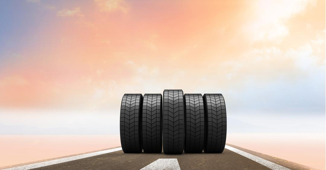 Digital composition of tyres on road against sky in the background