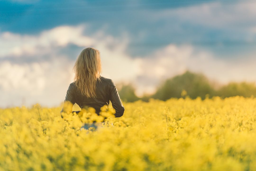 Woman in Yellow Field at Sunset Free Photo
