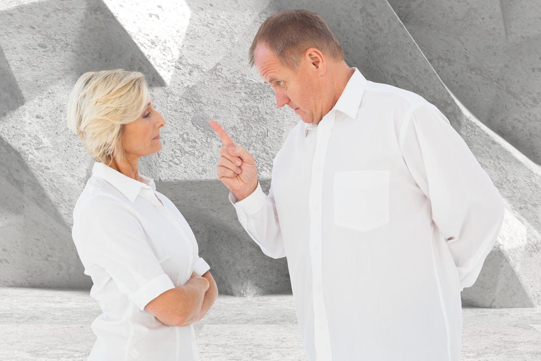 Digital composite of Senior man pointing at woman while arguing against gray background Free Stock Images from PikWizard
