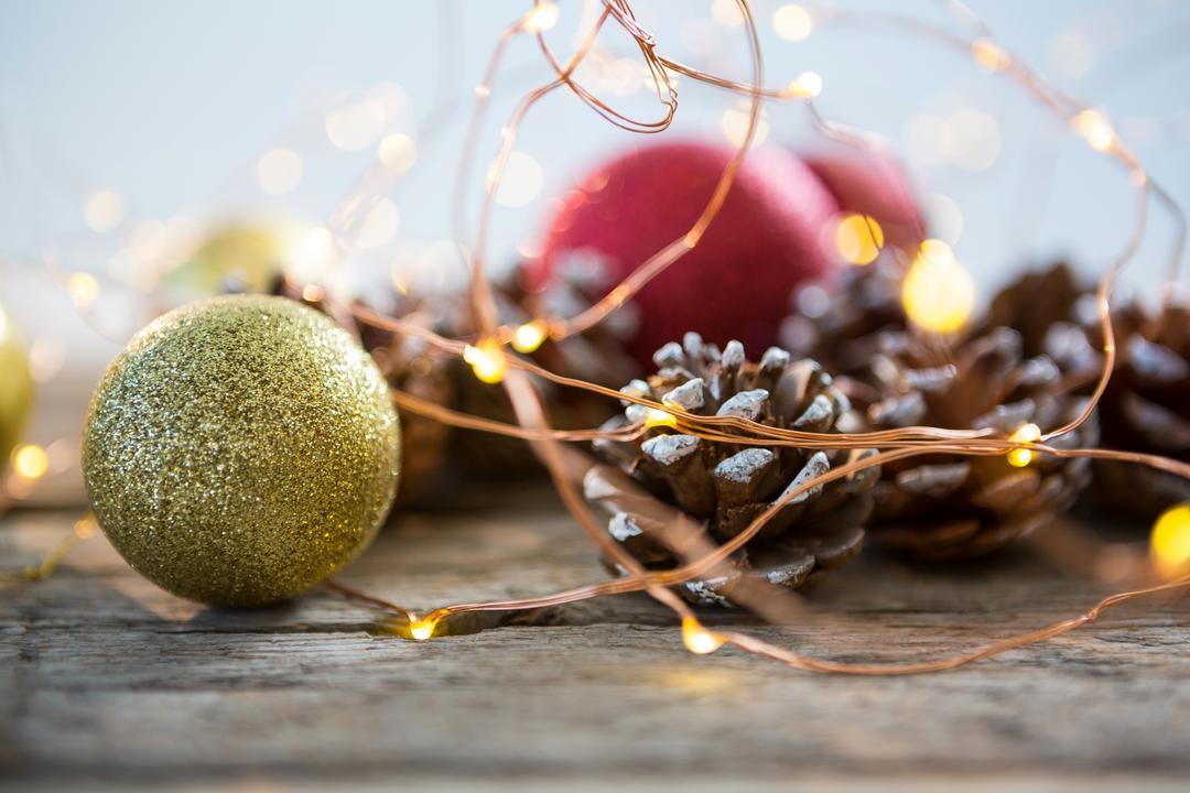 Christmas bauble ball on wooden plank during christmas time Free Stock Images from PikWizard